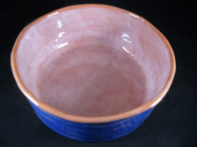 Hand-made ceramic dog bowl made using plaster mold, in earthenware clay, with underglazes and clear glaze